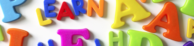 Macro composition of many colorful plastic toy letters and word